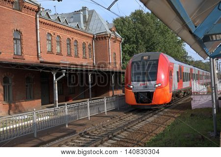 ST. PETERSBURG, RUSSIA - JULY 25, 2016: High-speed train Lastochka passes the station Shuvalovo. Produced by Siemens AG, the train can reach speeds up to 160 km/h