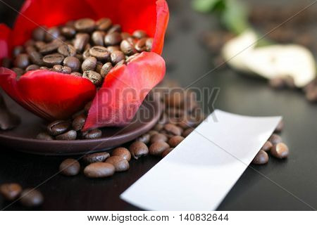 coffee beans in the bud red flower, paper with your signature.