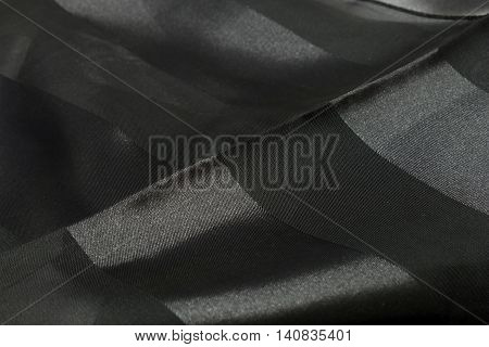 This is a photograph of Black Polyester scarf with lace insert
