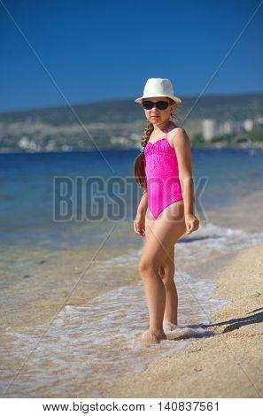 Little girl on sea coast