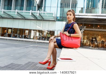 Business woman on background with a smart phone
