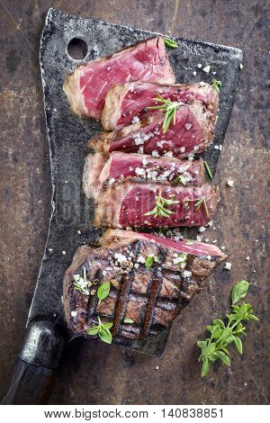 Barbecue Aged Roast Beef on old Metal Sheet