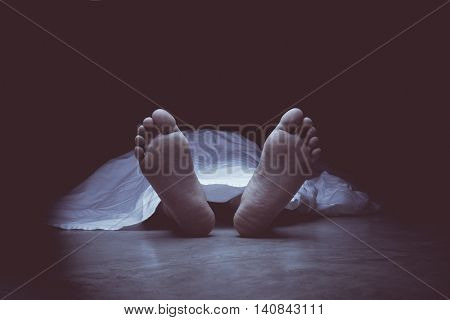 Vintage tone of the feet of dead body