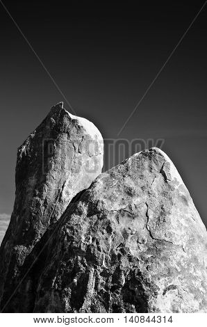 The Alabama Hills are a range of hills and rock formations near the eastern of the Sierra Nevada in the Owens Valley west of Lone Pine in Inyo County California United States.