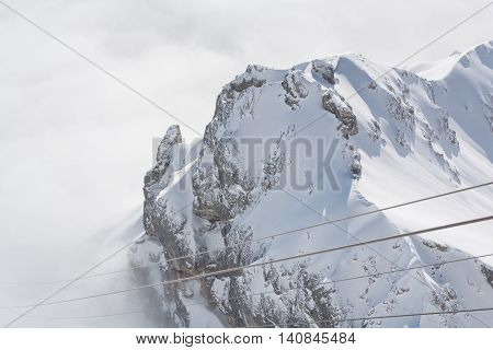 beautiful view on the Dachstein Mountains shrouded in a sea of fog - austria