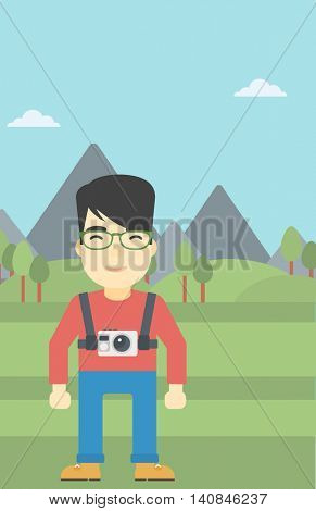 An asian man with a digital camera on his chest. Tourist with a digital camera standing on the background of mountains. Vector flat design illustration. Vertical layout.