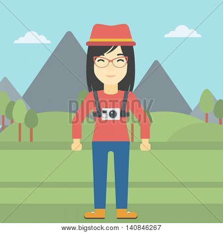 An asian woman with a digital camera on her chest. Tourist with a digital camera standing on the background of mountains. Vector flat design illustration. Square layout.