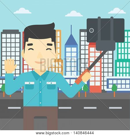 An asian man making selfie with a selfie-stick. Man taking photo with cellphone and waving on a city background. Vector flat design illustration. Square layout.