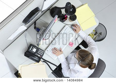 Overhead view of woman working at desk