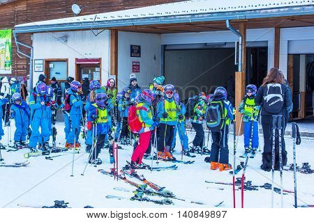 Bansko, Bulgaria - December, 12, 2015: Many young skiers preparing to ski in Bansko, Bulgaria