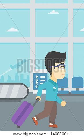 An asian young man with a suitcase walking at the airport. Vector flat design illustration. Vertical layout.