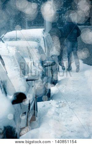 people walking on street during snowing in winter time.