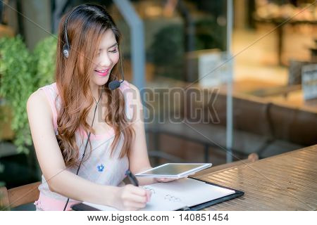 Portrait Of Woman Customer Service Worker, Call Center Smiling Operator With Phone Headset.
