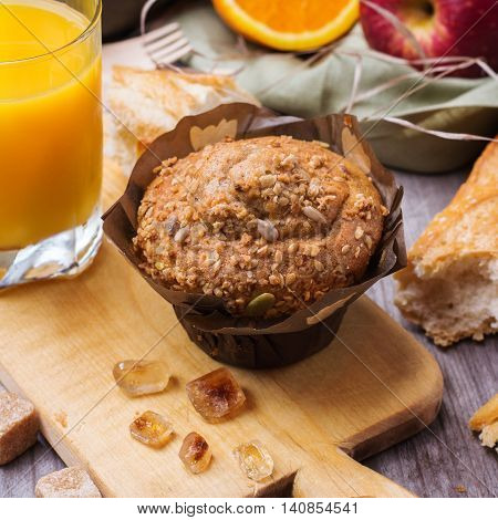 Still life, food and drink concept. Healthy muffin cake for breakfast on a rustic wooden table. Selective focus