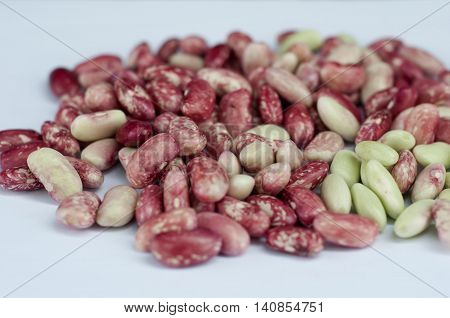 Food grains, vegetables, red and green ripe beans closeup