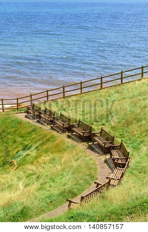 Row of empty benches on the top of the hill in Sidmouth Devon