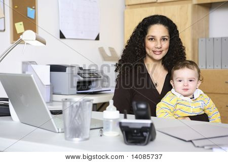 Woman and baby in home office