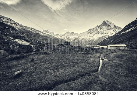 View of the himalayan peak the 6993 ms. mount Machhapuchhare-Fish Tail from Annapurna Base Camp Nepal. Black & White.