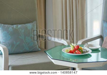Some fruits strawberries melon papaya jackfruit watermelon kiwi dragon fruit and lemons are decorated on plate Interior design.