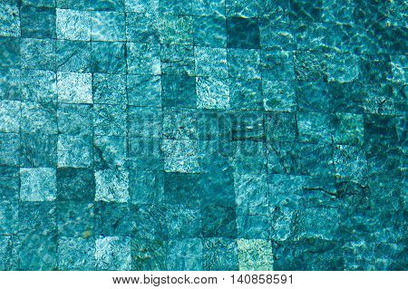 colorful water surface with sun reflections. Ideal swimming pool sea and ocean texture.