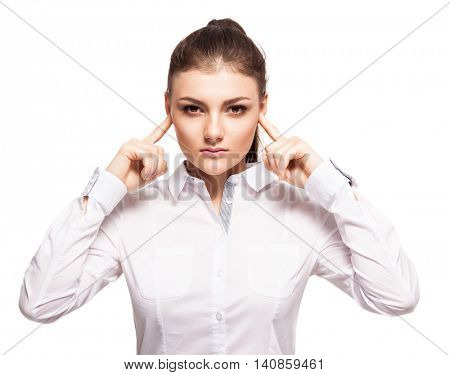 Woman at white background. Young female covering her ears. Ignorance