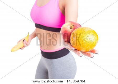 Close-up Of Girl Hand Holding Orange And Apple