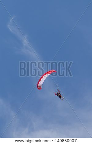 Copenhagen, Denmark - July 30, 2016: A skydiver just before landing in a lake for the Swoop Challenge.