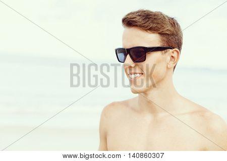 Handsome man posing at beach