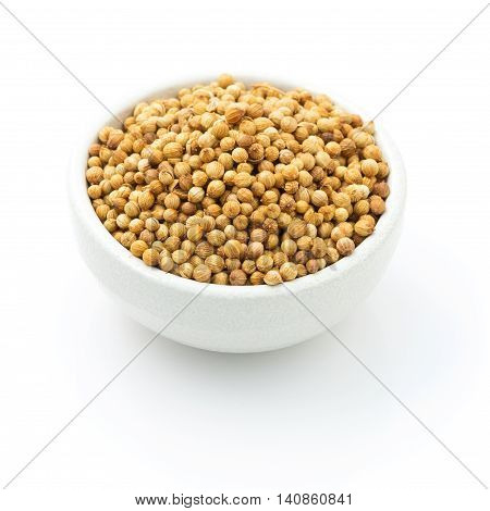 coriander seeds in a bowl for add Flavor to Your Food on white isolated on white.