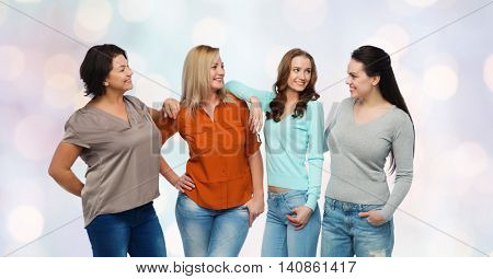 friendship, fashion, body positive, diverse and people concept - group of happy different size women in casual clothes over holidays lights background