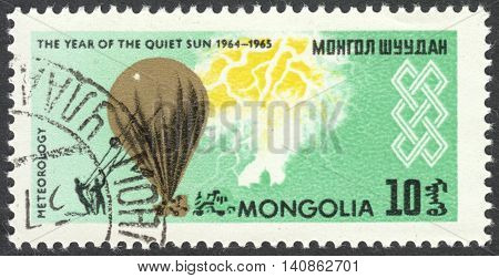 MOSCOW RUSSIA - CIRCA APRIL 2016: a post stamp printed in MONGOLIA shows a meteorological balloon the series