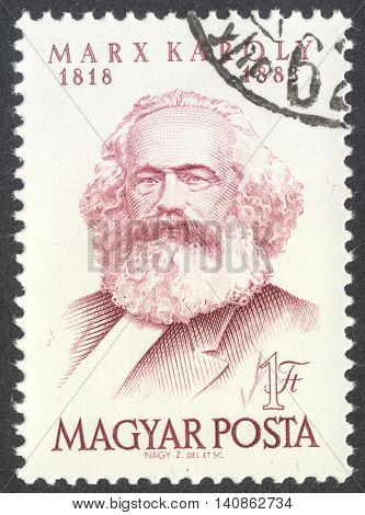 MOSCOW RUSSIA - CIRCA APRIL 2016: a post stamp printed in HUNGARY shows a portrait of Karl Marx dedicated to the 70th Anniversary of the Death of Karl Marx circa 1953