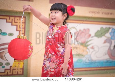 Asian Chinese Girl  In Traditional Chinese .hold Red .paper Lanterns
