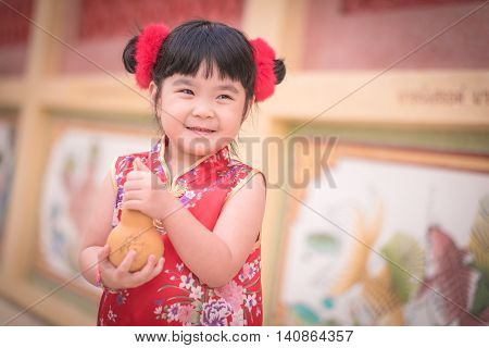 Asian Chinese Girl In Traditional Chinese Hold Calabash