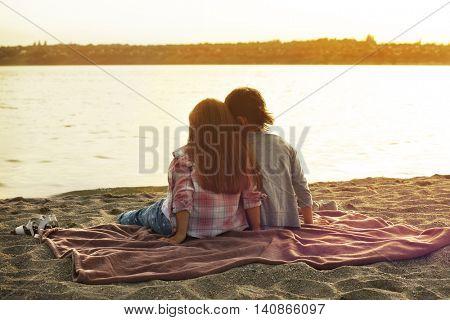 Two cute kids relaxing on beach