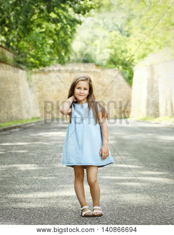 Cute girl posing on street