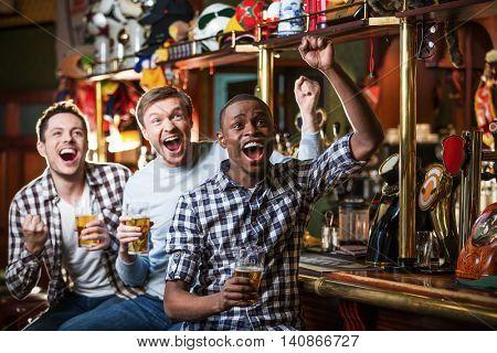Expression fans with beer indoors
