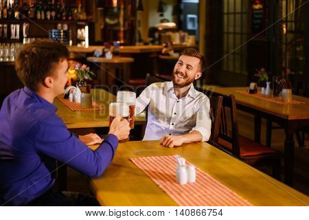 Young smiling men in a pub