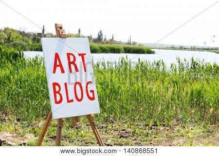 Easel with canvas outdoors. Art blog concept