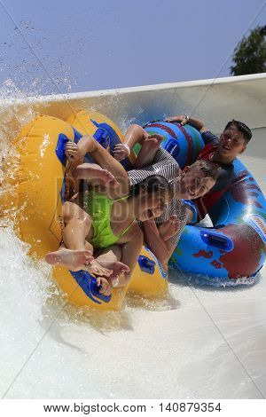 Rhodes Greece-July 30 2016: The group of children on the rafting slide in the Water park.Rafting slide is one of many popular game for adults and children in park.Water Water Park is located on the island of Rhodes in Greece and one of the largest