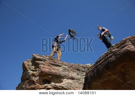 Rock climber thows rope
