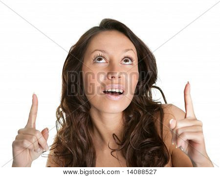 Cheerful women point up to copyspace
