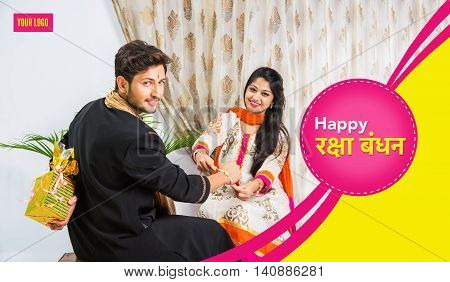 season's greeting card showing Indian young male and his sister celebrating Rakhi festival or raksha bandhanor Rakshabandhan  in traditional attire