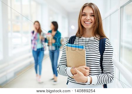 Portrait of beautiful smiing female college student