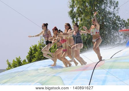 Rhodes Greece-July 30 2016: Group of girls and women on the vet bubble.Vet bubble is very popular for young people in the Water Park.Water Water Park is located on the island of Rhodes in Greece and one of the most largest in Europe and is a very popular