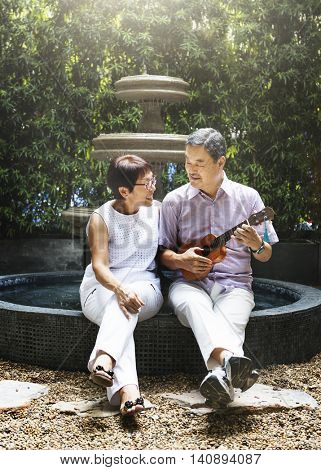 Senior Couple Ukulele Romantic Fountain Concept
