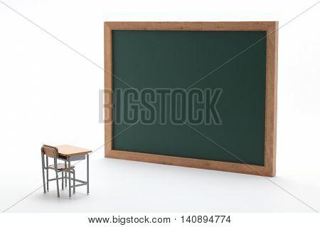 Miniature blackboard and desk on white background.