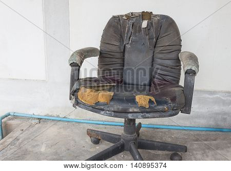 Black Office chair old damage leather and dirty time