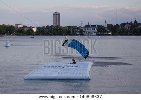 Copenhagen, Denmark - July 30, 2016: A skydiver landing on a pontoon in a lake for the Copenhagen Swoop Challenge.