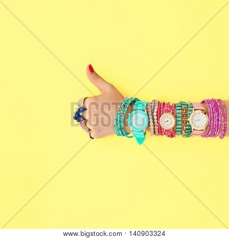 Fashion. Accessories fashion Set. Female hand YES Gesture Stylish Trendy Wrist Watches, Glamor bracelets and rings. Summer fashion girl Outfit, accessories. Hipster Essentials. Minimal fashion style